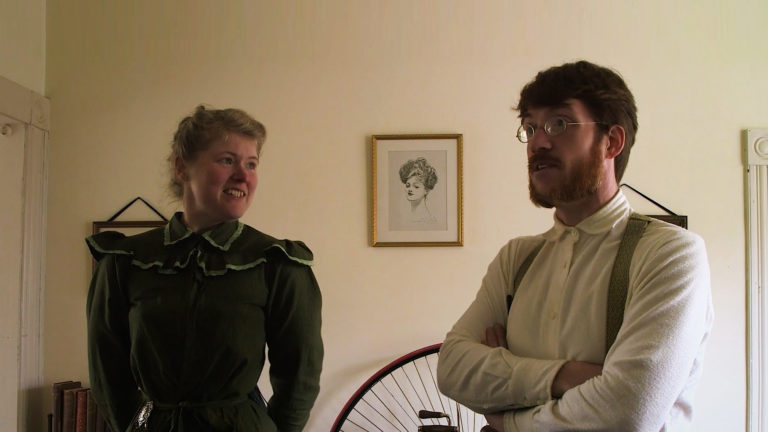 two people in victorian clothing being interviewed