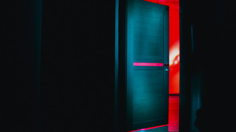 door revealing a red lit room
