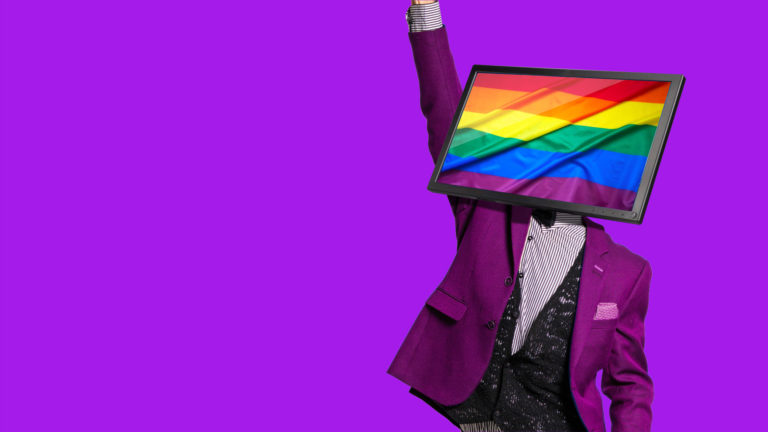 image of person in suit with monitor for a head showing pride flag