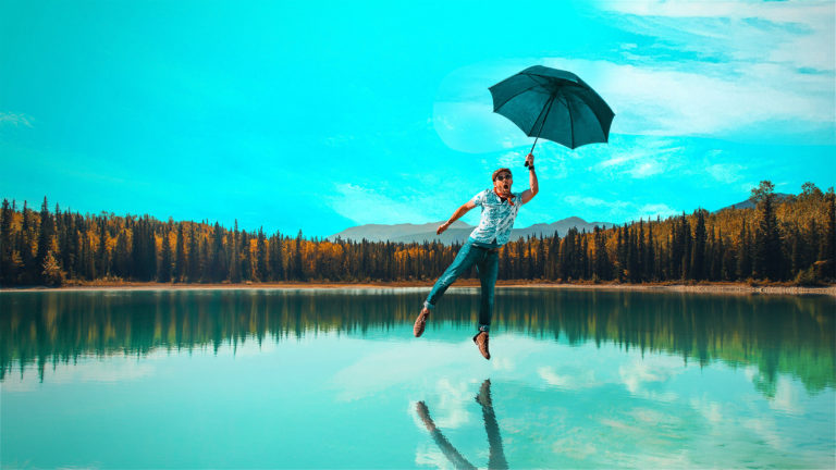 Man flying holding a umbrella