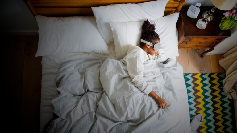 african-american-woman-on-bed-sleeping-with-a-sleeping-mask
