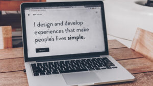website open on a laptop that says i design and develop experiences that make people's lives simple