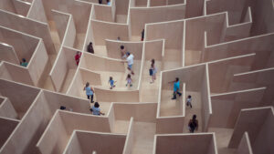 birds eye view of a number of people exploring a maze