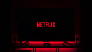 netflix logo on television screen with red led glow in the background