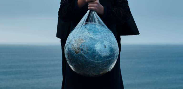 A person holding earth globe