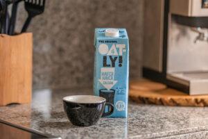 Oatly brand oak milk on a kitchen table.