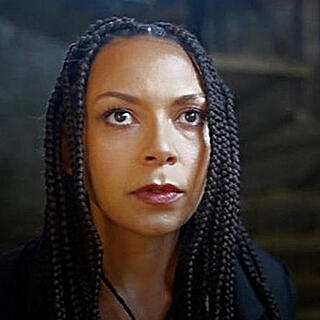 close up of a Black woman's face staring upwards